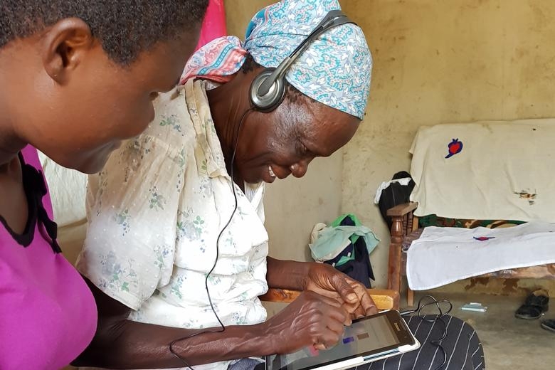 Woman completes survey on tablet in Kenya