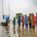 Women queueing at aid station in flood water in Bangladesh