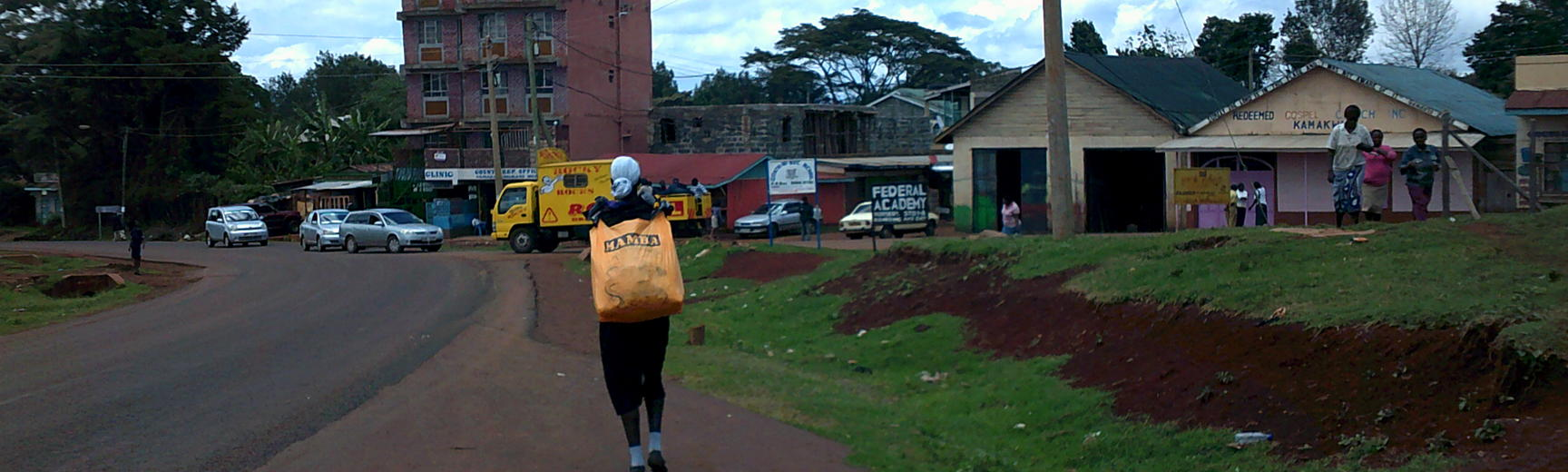 Person carrying chewing gum in a bag to sell in Kenya