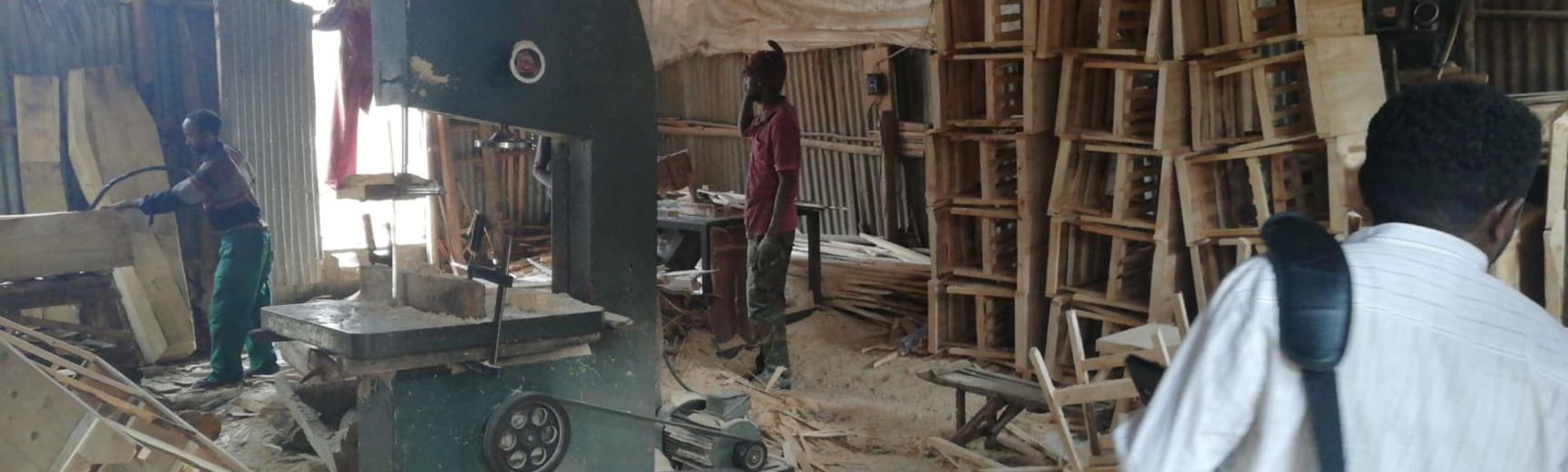 Men working in a messy factory in Addis Ababa