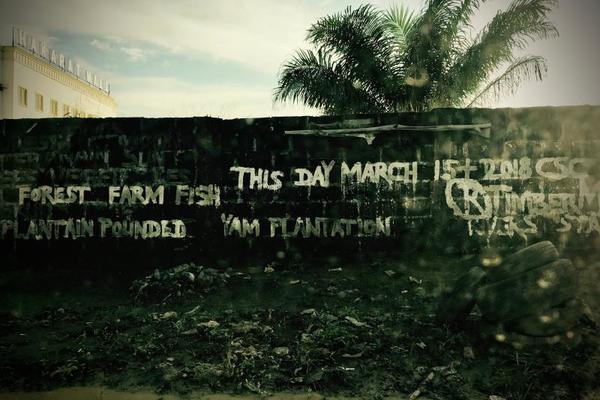 Graffiti on a wall on Obi Wale Street in Port Harcourt